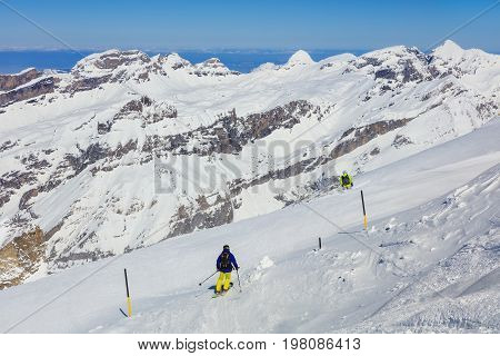 Mt. Titlis, Switzerland - 9 March, 2016: people skiing on Mt. Titlis. The Titlis is a mountain located on the border between the Swiss cantons of Obwalden and Bern, mainly accessed from the town of Engelberg on the northern side.
