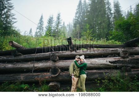 incredibly beautiful and young couple walking in the  forest