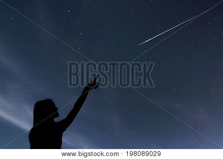 Girl Looking At The Stars. Girl Making A Wish By Seeing A Shooting Star.