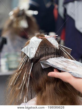 weave hair in beauty salon . A photo