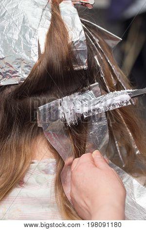 weaving hair in beauty salon . A photo