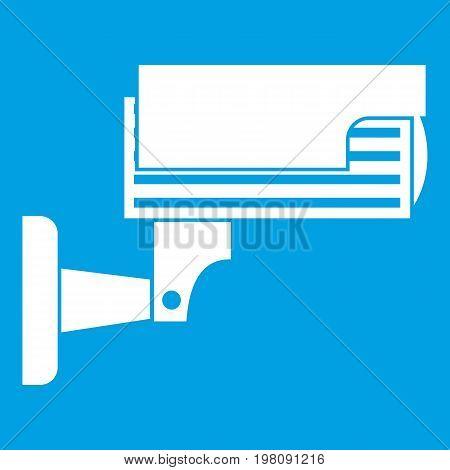 Surveillance camera icon white isolated on blue background vector illustration