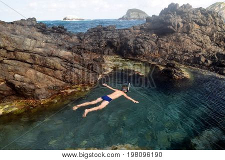 Swimming in a natural pool in Fernando de Noronha