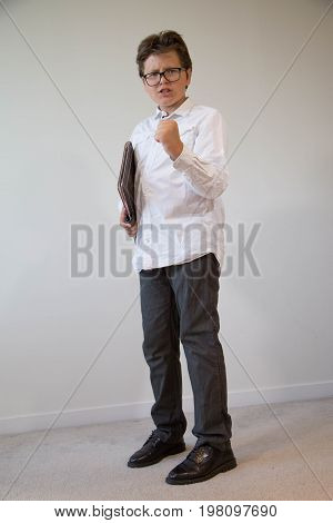 Confident facial expression young boy energizing gesture concept leadership