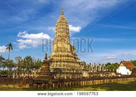 Old pagoda Wat Phra Si Ratanamahathat temple and blue sky in Sisatchanalai Historical Park Sukhothai province Thailand