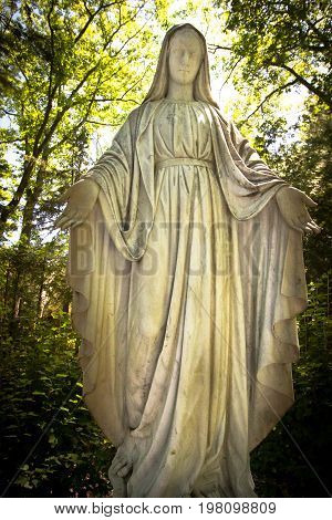 Indian River, Michigan, USA - July 25, 2017: Statue of the Blessed Mother  Mary at the Cross In The Woods Shrine in northern Michigan.