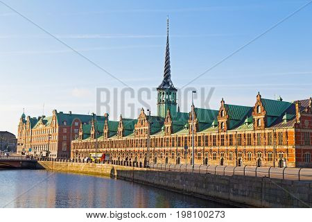 Old Stock Exchange along the canal in Copenhagen Denmark. Former stock exchange building along the canal with a distinctive spire.