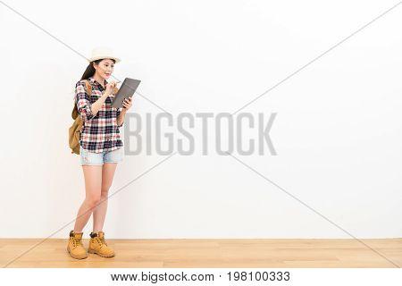 Female Backpacker Using Digital Tablet Computer