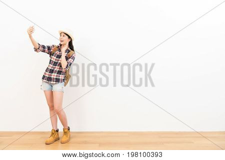 Woman On White Background Using Mobile Phone