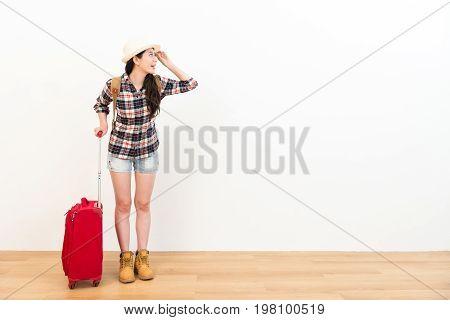 Female Backpacker Carrying Travel Luggage Suitcase