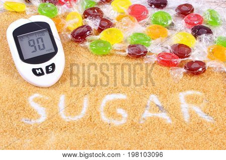 Glucometer, Colorful Candies And Granulated Brown Cane Sugar, Concept Of Diabetes