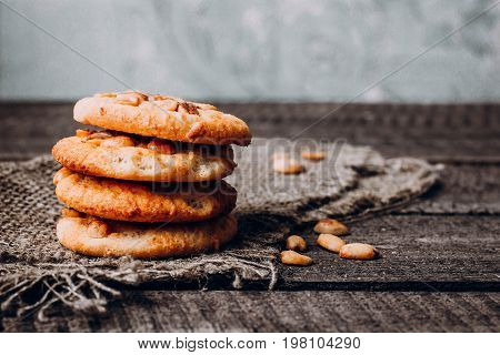 Close up Stack of Oatmeal cookies with peanuts on dark rustic wooden background table. Close up copy space