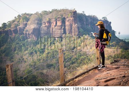 Tourist Young Woman  Looking Location On Tablet To The Mountain, Woman Reading Map. Tourism Concept.