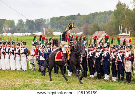 BORODINO RUSSIA - September 06 2015 - Reenactment of the battle of Borodino (the Patriotic war of 1812 year). Tourists watch the performance from from the fenced places. Moscow region Russia.