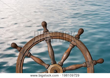 Steering wheel and ocean surface 3d illustration