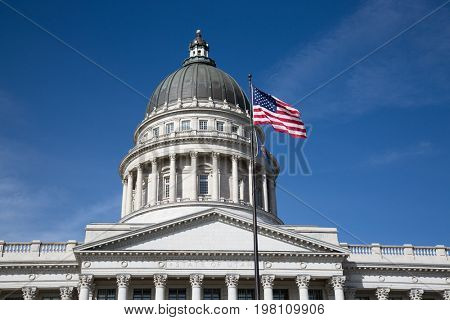 Salt Lake City, Utah, USA - October 8, 2016. Facade of the Utah State Capitol decorated with national flags.