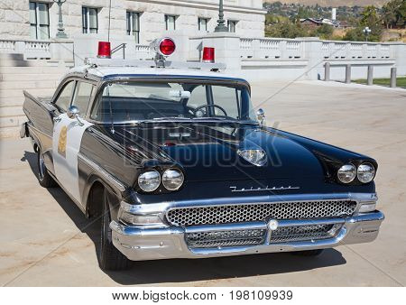 Salt Lake City, Utah, USA - October 8, 2016. Historical police car in front of the Utah State Capitol.