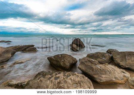 Seashore in cloudy weather. Long exposure time