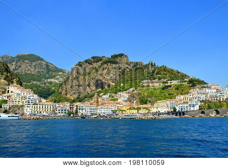 View of the beautiful town of Amalfi at famous coast in gulf of Salerno. Campania region, Italy.