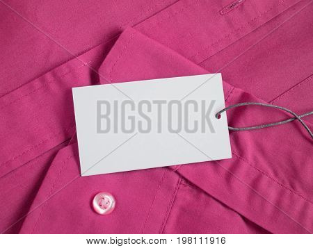 Price tag on red shirt mockup for price or brand presentation.