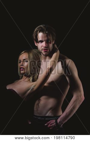 Love and romance. Relations of girl and guy. Boyfriend and girlfriend on black. Man with muscular body with sexy girl. Couple in love of sexy man and woman.