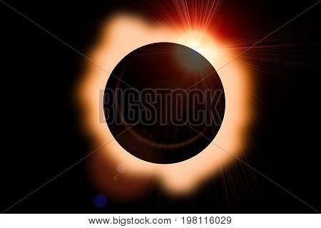Solar eclipse with orange halo on black sky background.