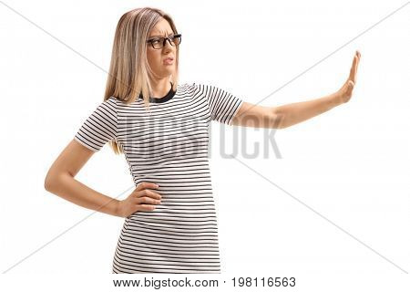Young woman making a refuse gesture with her hand isolated on white background