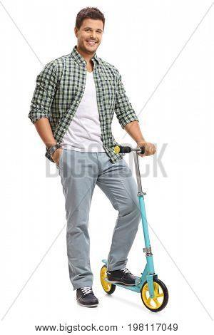 Full length portrait of a young guy with a scooter isolated on white background