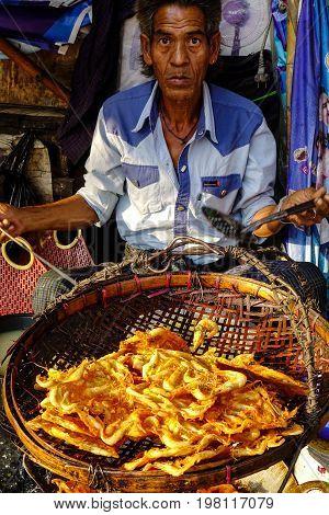 Vendor Selling Street Food In Yangon, Myanmar