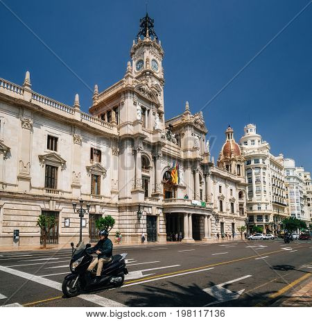 Valencia Spain - June 2 2017: Biker in front of the City Hall in Valencia Spain. Spanish architecture of neoclassical and baroque gives name to the square Plaza del Ayuntamiento.