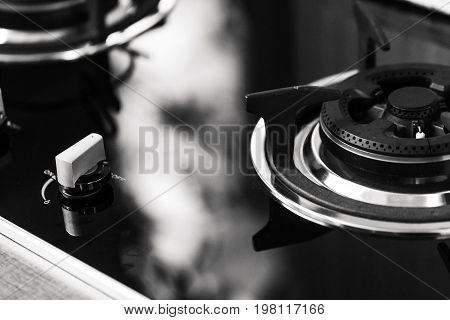 Closeup Clean New Kitchen Gas Stove Cooker Knob Heat Volume Switch Elegant Metal Steel Black And Whi