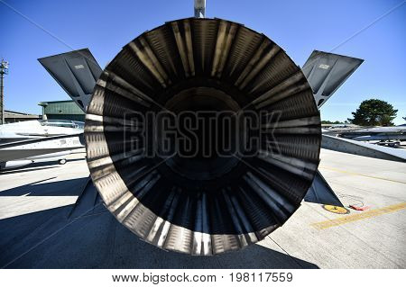 Fighter aircraft exhaust detail on the runway