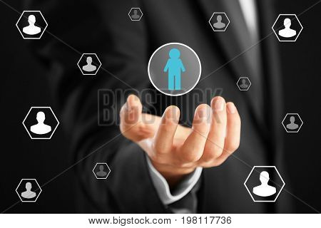 Man holding employee icon, closeup. Concept of human resources management
