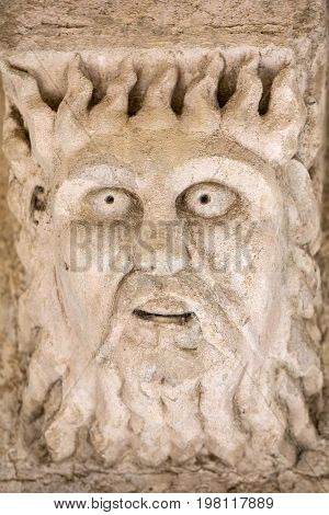 Romanesque Carving of a Strange Head or Face (c12th) Capital in Cloisters of Montmajour Abbey near Arles Provence France