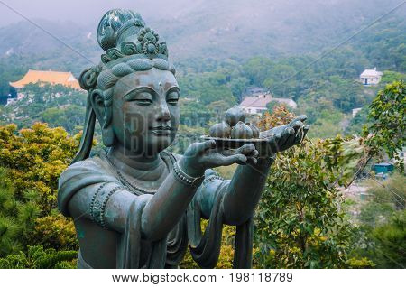 Bronze buddhistic statues praising and making offerings to the Tian Tan Buddha - Big Buddha.