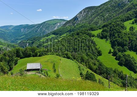 Green Countryside Landscape In The Mountains