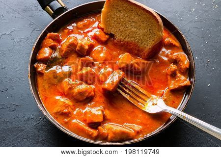 Fork And Bread In A Frying Pan With Stew