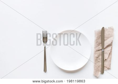Empty Plate On A White Background And Cutlery On A Napkin Mockup