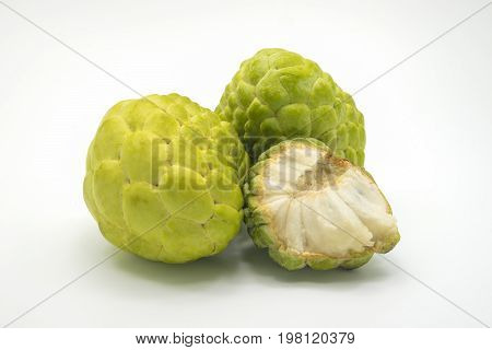 Two custard apples and one half custard apple isolated on background.