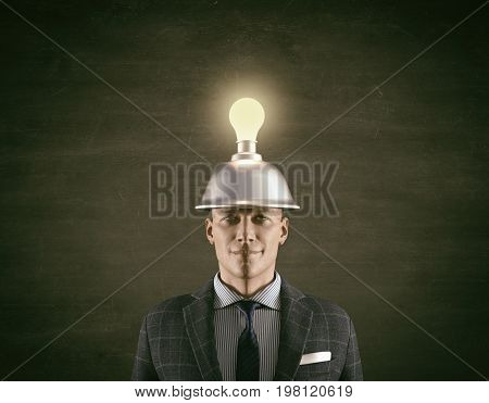 Conceptual image of a businessman and a light bulb overhead.This is a 3d render illustration.