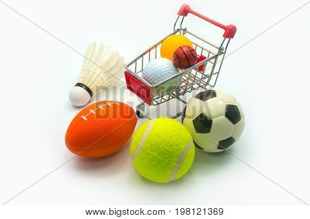 Sports Concept : Various sports ball including badminton soccer (football) rugby tennis golf table tennis (ping-pong) small basketball alongside supermarket trolley. On white background.