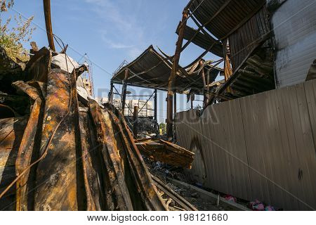 Huge heap of metal rubbish, beam and overlapping left after the fire the building burned to the ground