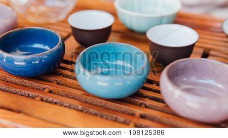 Ceramic Multicolored Bowls For The Chinese Tea Ceremony Close-up. Cups For Tea Ceremony Standing On