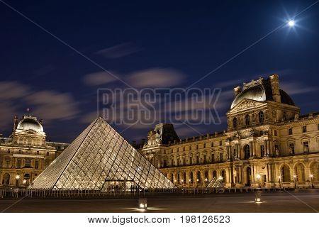 PARIS, FRANCE - JUNE 06, 2017 : Louvre museum with pyramid in twilight