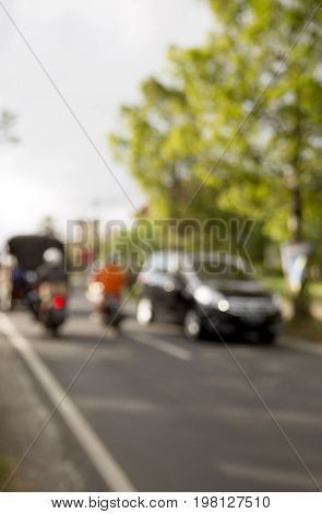 Road movement of motobike and cars in asian style