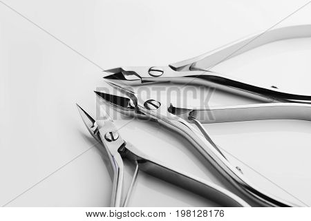 Tools of a manicure scissors on a white background