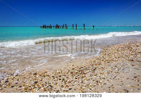 landscape coastline destroyed rusty pier the contrast between nature and human activities
