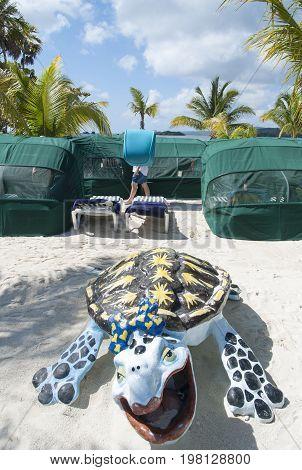 The turtle toy on a beach of Roatan Island (Honduras).