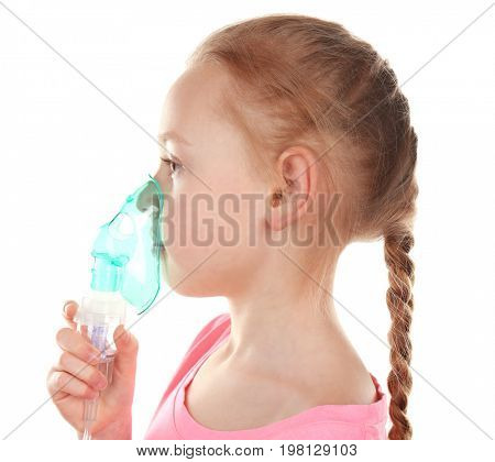 Girl using asthma machine on white background