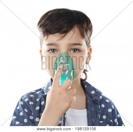 Boy using asthma machine on white background